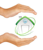 Hands preserving small house — Stock Photo