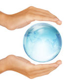 Hands preserving half earth globe isolated on white — Stock Photo