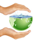 Hands around half earth globe with water splashing — Stock Photo