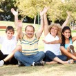Young family having fun in park — Stock Photo #6400139
