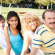 Portrait of family relaxing in park — Stock Photo