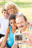 Happy family taking self portrait — Stock Photo