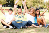 Young family having fun in the nature — Stock Photo