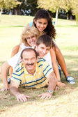 Family lying on top of each other — Stock Photo