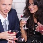 Couple on date in bar or night club enjoying wine — Stock Photo