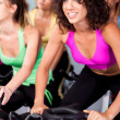 Group of four spinning in fitness club — Stock Photo