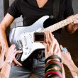 Постер, плакат: Guitarist playing for is fans