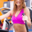 Stock Photo: Young fit womdoing cardio exercise