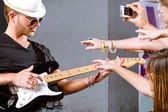 Selective focus on guitarist in action — Stock Photo