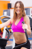 Young fit woman doing cardio exercise — Stock Photo