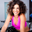 Stock Photo: Young womsmiling doing cardio exercise