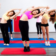 Stock Photo: Group of women, stretching