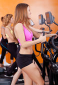 Group of four in the gym — Stock Photo