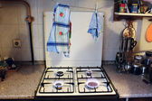 Gas stove. Linens. Fire safety. — Stock Photo