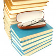 Pile of old books and glasses — Stock Photo