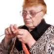 The old woman is engaged in knitting — Stock Photo
