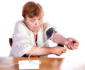 The old woman measures arterial pressure upon — Foto Stock