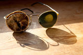 Old glasses with a dry lemon — Stock Photo