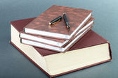 Thick book volume notebooks and pen — Stock Photo