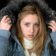 The girl in warm jacket with a hood — Stock Photo