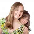 Two smiling girls isolated — Stock Photo