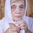 Portrait of the old woman in a kerchief — Stock Photo