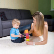 Young mother playing with baby boy — Stock Photo #5571520