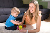 Young mother playing with baby boy — Stock Photo