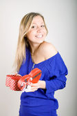 Woman with a red present gift — Stock Photo