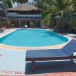 A beautiful large swimming pool at a local resort - Foto de Stock  