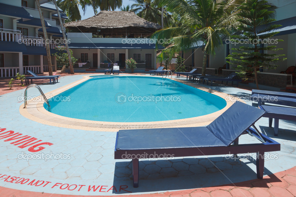 A beautiful large swimming pool at a local resort stock for Local swimming pools