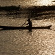 Man in canoe. Kerala backwaters, India - Stock Photo