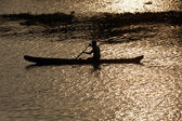 Man in canoe. Kerala backwaters, India — Stock Photo