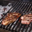 Sirloin steak prepared on the barbecue grill. - Stock Photo