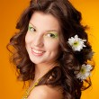 Portrait of beautiful girl with flowers in her hair — Stock Photo