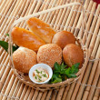 Bread in braided basket - Stock Photo
