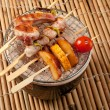 Stock Photo: Japanese skewered seafoods vegetables