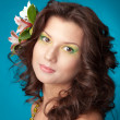 Portrait of beautiful girl with flowers in her hair — Stock Photo #6028833