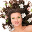 Stock Photo: Portrait of beautiful girl with flowers in her hair