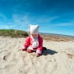 Little baby girl on the beach . — Stock Photo