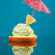 Photo of cutted orange with ice cream . - Stock Photo