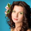 Girl with flowers in her hair — Stock Photo #6029518