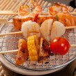 Japanese skewered seafoods vegetables — Stock Photo #6030992