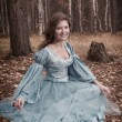 Lgirl in medieval dress in autumn wood — Stock Photo