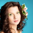 Portrait of beautiful girl with flowers in her hair — Stock Photo #6031629