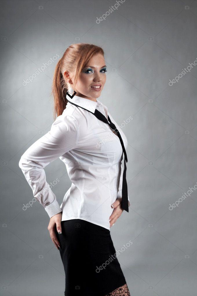 redheaded girl in formal dress white shirt � stock photo