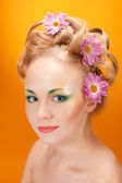 Portrait girl blonde with flowers in her hair — Stock Photo
