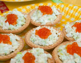 Tartlet with red caviar — Stock Photo