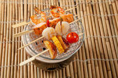Japanese skewered seafoods vegetables — Stock Photo