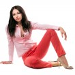 Beautiful young woman in red jeans — Stock Photo